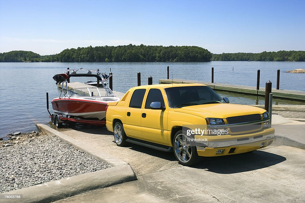 Boat and truck on boat launch : Stock Photo