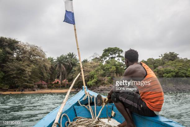 Boat approaches Dublin in Sierra Leone's Banana Islands. The Banana Islands were once a slave trading port. They are now home to a few hundred...