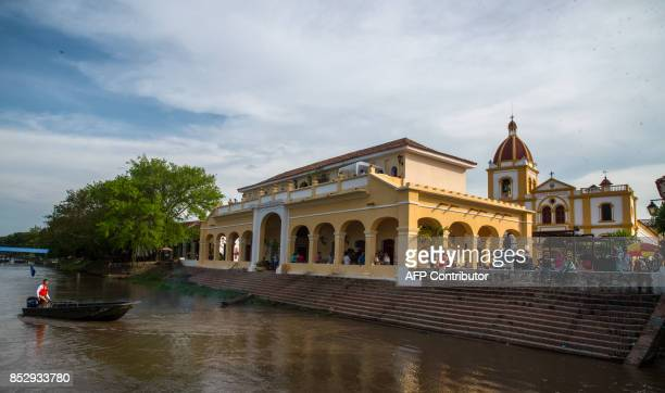 A boat arrives at the river port in Santa Cruz de Mompox a town on the banks of the Magdalena River in the northern Colombian department of Bolivar...