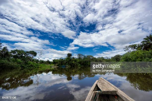boat arriving to village - iquitos stock pictures, royalty-free photos & images