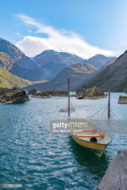 boat at bondhusvatnet in sunndal norway - finn bjurvoll stock pictures, royalty-free photos & images