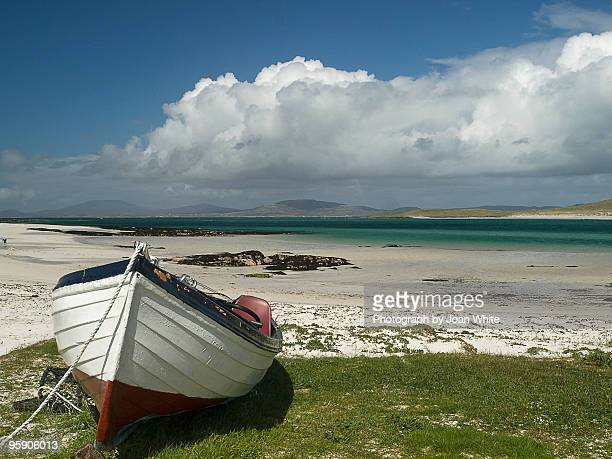 boat at eoligary on barra - barra scotland stock pictures, royalty-free photos & images