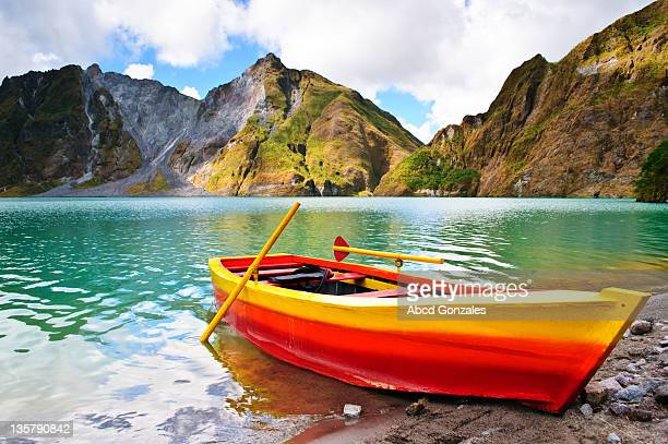 boat at mountain's crater lake - mt pinatubo stock photos and pictures