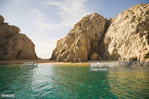 boat at secluded beach - cabo san lucas stock pictures, royalty-free photos & images