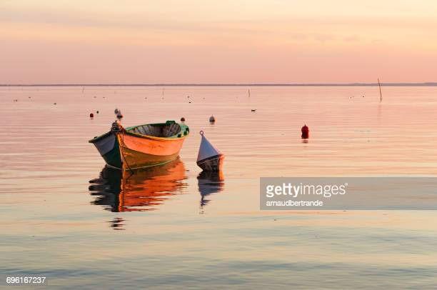 boat at sunset, andernos-les-bains, gironde, france - buoy stock photos and pictures