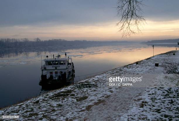 Boat at sunset on the Danube near Mohacs Hungary