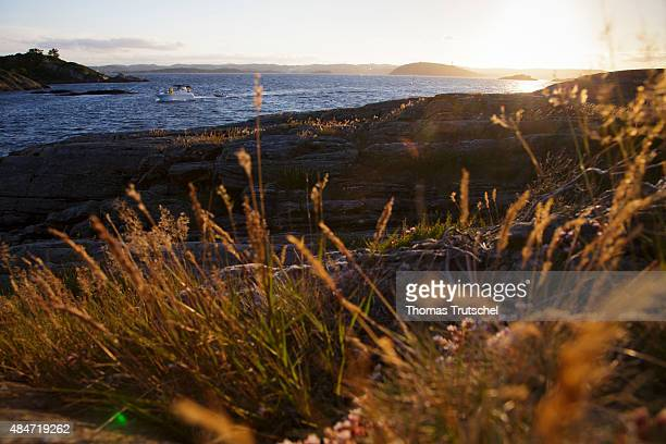 A Boat at the coast and the sea at a fjord on July 06 2015 in Kristiansand Norway