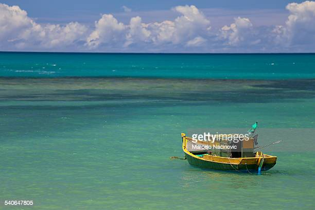 boat at the green sea of espelho beach - espelho stock pictures, royalty-free photos & images