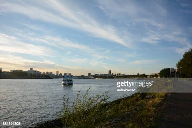 boat at the river of neuwe maas rotterdam - meuse river stock photos and pictures