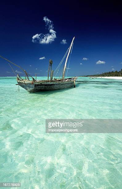 a boat at the tanzania zanzibar east coast - zanzibar island stock photos and pictures