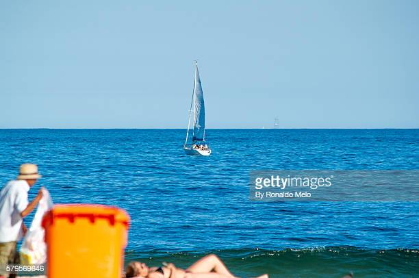 Boat background and woman sunbathing on the beach