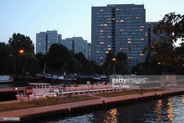 A boat bearing tourists passes through a lock on the Spree river in Mitte district on September 6 2012 in Berlin Germany The apartment buildings...