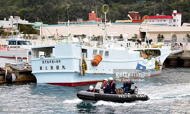 A boat believed to have been used by the suspects to smuggle narcotics is docked in Naze Port on February 11 2016 in Amami Kagoshima Japan In a...