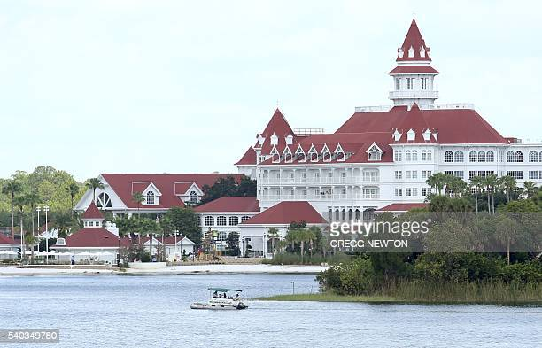 A boat belonging to the Orange County Sheriff's office searches the Seven Seas lagoon ouside Disney's Grand Floridian Resort Spa near Orlando Florida...