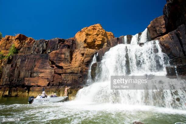 Boat below waterfall on the Berkley River in Western Australia
