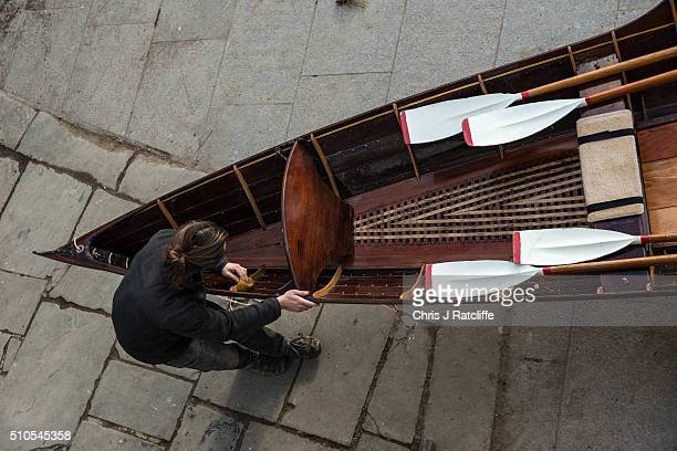 Boat builder Eddie Knight assembles a Thames Skiff, dating from 1890, after renovation at the traditional Richmond Bridge Boathouses on the banks of...