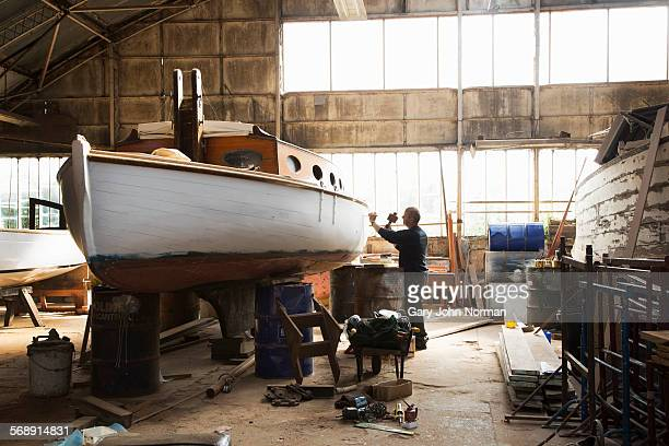 boat builder working in his workshop. - caucasian ethnicity stock pictures, royalty-free photos & images
