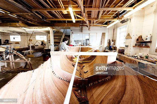 Boat builder working on the craft interior