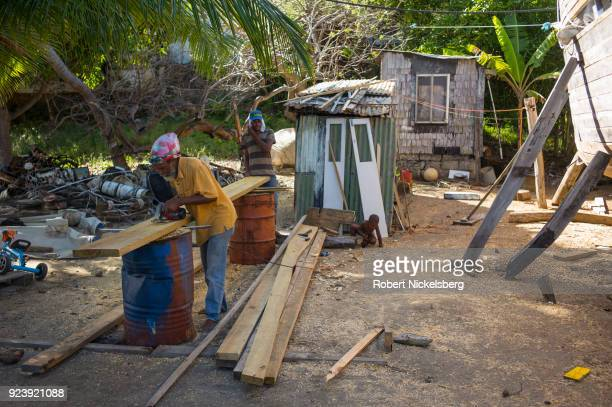 WINDWARD CARRIACOU GRENADA FEBRUARY 6 Boat builders Curtis St Hilaire left and Ricky Patrice center cut a tapered plank made of pitch pine wood for a...