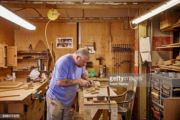 boat building craftsmen - concentration stock pictures, royalty-free photos & images