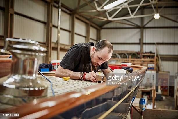 boat building craftsmen - craftsperson stock pictures, royalty-free photos & images