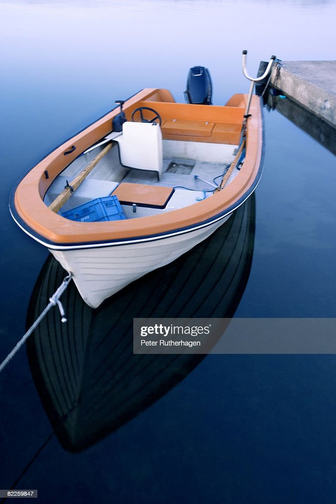 A boat by a jetty in Gotland Sweden. : Stock Photo