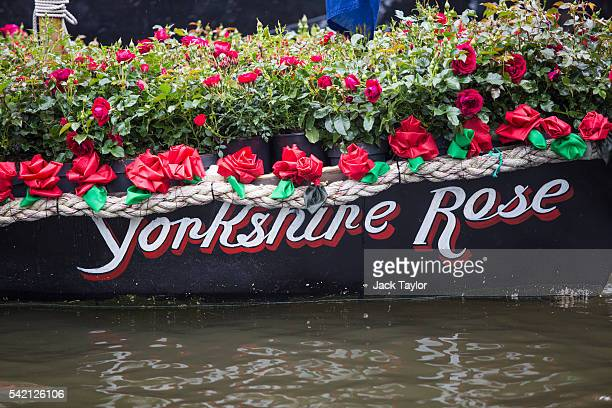 Boat called 'Yorkshire Rose', filled with roses is moored next to the houseboat of the late Jo Cox at Hermitage Moorings on the River Thames, June...