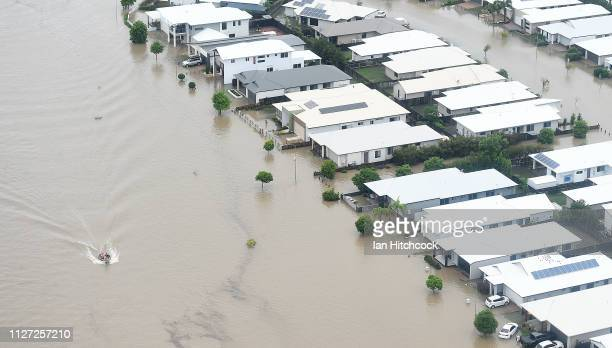 A boat can be seen motoring along a flooded road on February 04 2019 in Townsville Australia Queensland Premier Annastacia Palaszczuk has warned...