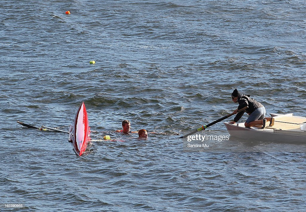 A boat capsizes at the start during the New Zealand Junior Rowing Regatta on February 23, 2013 in Auckland, New Zealand.