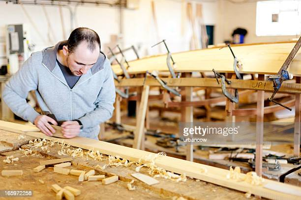 Boat carpentry, using a wood plane