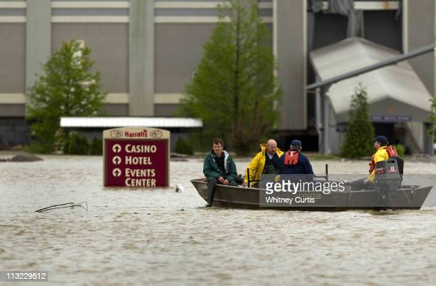 A boat carries passengers to Harrah's Casino which was closed due to flooding April 27 2011 along the Ohio River in Metropolis Illinois Severe storms...