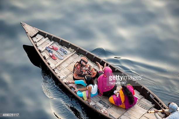 Boat carrying Bengalese on black water, Dhaka, Bangladesh
