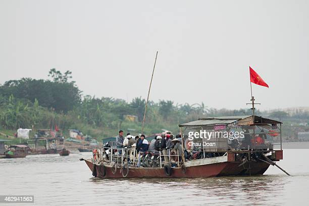 A boat carrying people and children on the Khuyen Luong ferry crosses to Van Duc village The people who live in Van Duc floating village earn their...
