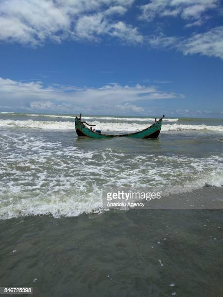 A boat carrying Rohingya Muslims fled from ongoing military operations in Myanmars Rakhine state sinks while helping refugees flee to a temporary...