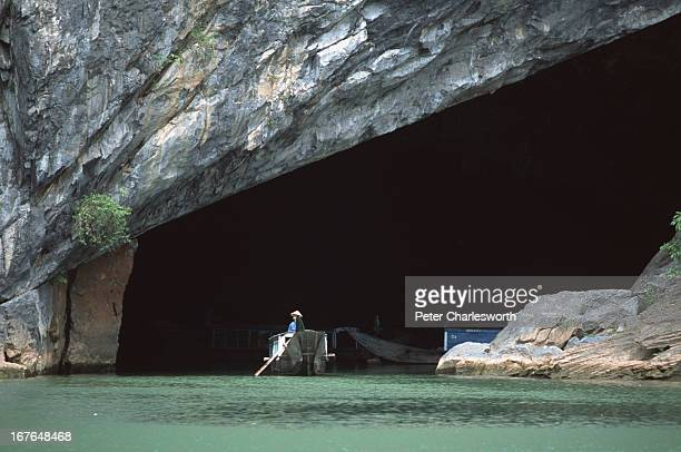 A boat carrying tourists enters the Phong Nha Caves The caves can be found near the Phong Nha Nature Reserve and boats can travel long distances...