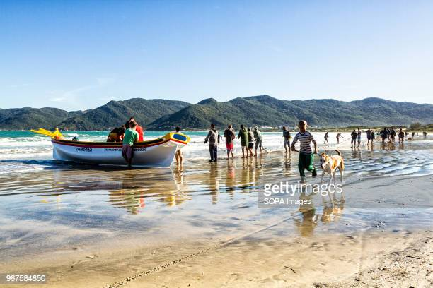 Boat coming in during the grey mullet fishing season Grey mullet fishing in Pantano do Sul beach starts on May 1st and ends on July 31 and is a...