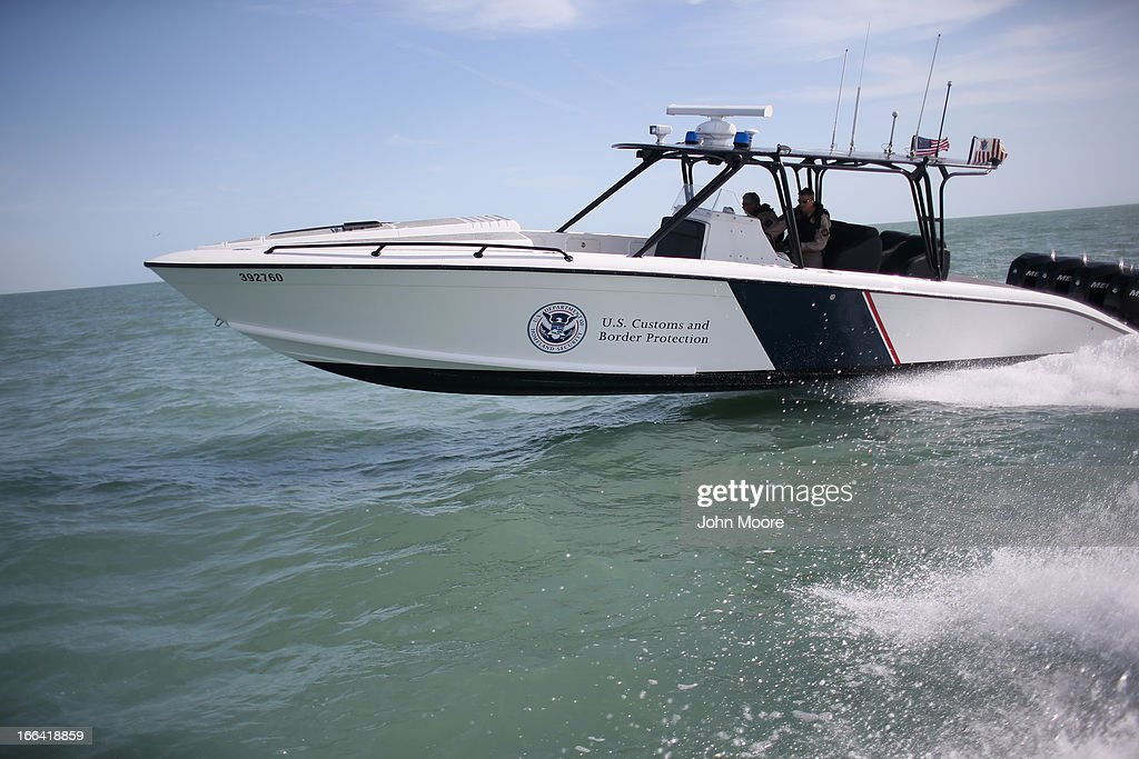 A boat crew from the U.S. Office of Air and Marine (OAM) races through the Gulf of Mexico on April 12, 2013 near Port Isabel, Texas. The crew patrols coastline waters near the U.S.-Mexico border searching for drug smugglers as well as illegal immigrants, which come across from Mexico near the mouth of the Rio Grande River. Their boat, a Midnight Express interceptor, is a 39 foot 900 horsepower craft capable of chasing smugglers down at 55 knots (63 mph). OAM units also push back illegal fishing boats out of U.S. waters.