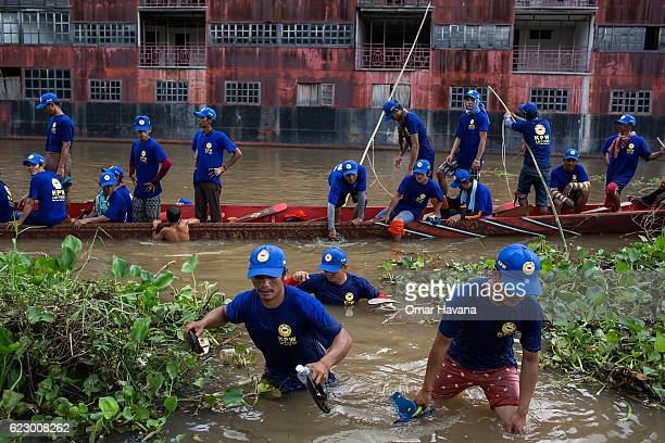 Boat crew members get out of their racing boat after training on the waters of the Tonle Sap River on the morning of the first day of the Water...