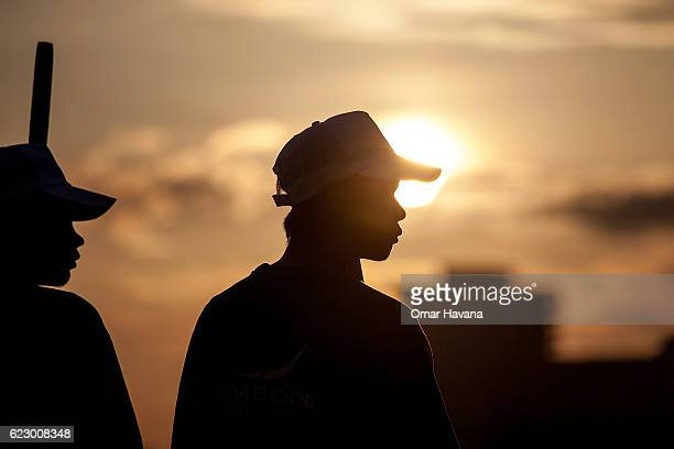 Boat crew members stand on their racing boat before training on the morning of the first day of the Water Festival on November 13 2016 in Phnom Penh...