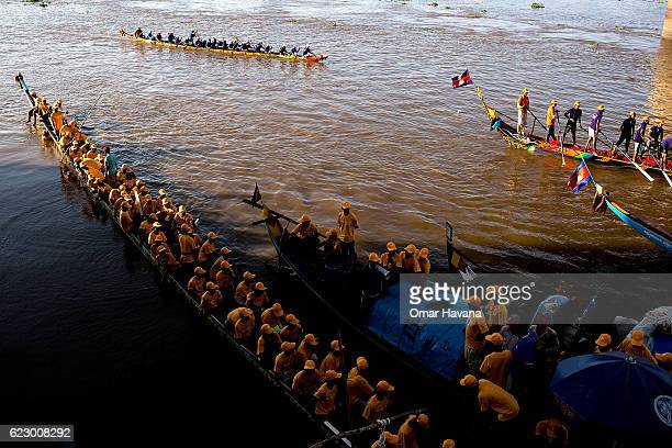 Boat crew members train on the waters of the Tonle Sap River on the morning of the first day of the Water Festival on November 13 2016 in Phnom Penh...