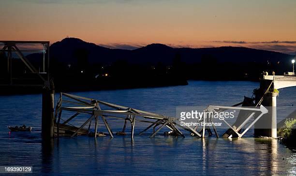 Boat cruises past the scene of a bridge collapse on Interstate 5 on May 23, 2013 near Mt. Vernon, Washington. 1-5 connects Seattle, Washington to...