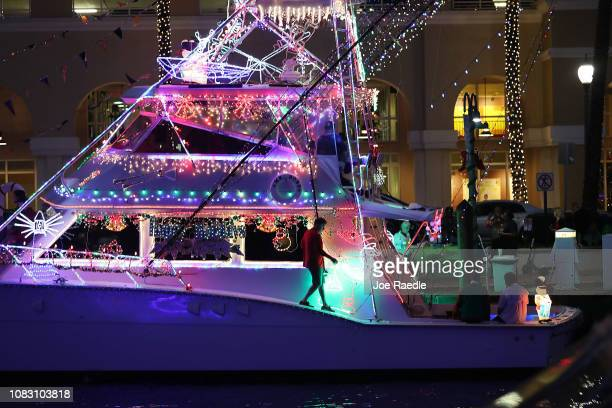 A boat decked out with holiday decorations is seen along the New River while participating in the 47th annual Seminole Hard Rock Winterfest Boat...