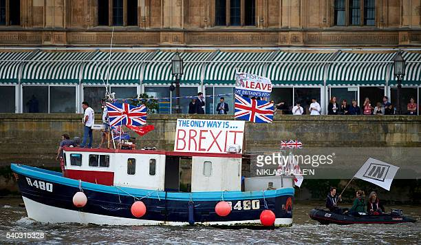 A boat decorated with flags and banners from the 'Fishing for Leave' group that are campaigning for a 'leave' vote in the EU referendum sails by the...