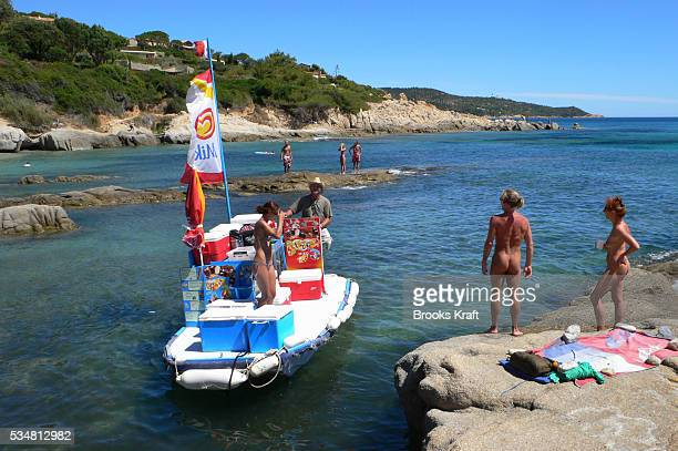 A boat delivers food and beverages to a beach with nude sunbathers along the coastline along of the Bay of Bonporteau in Ramatuelle France August 4...
