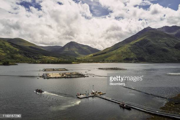 A boat departs from the jetty at the Loch Leven salmon farm operated by Mowi ASA near Fort William UK on Wednesday June 19 2019 Saudi Arabia is a...
