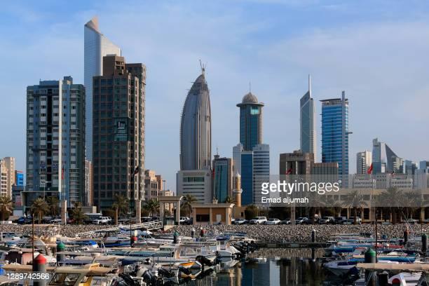 boat dock along shouq sharq marina, kuwait city, kuwait - kuwait city stock pictures, royalty-free photos & images