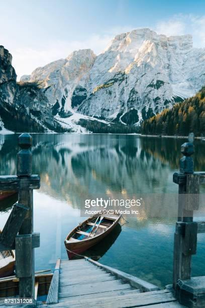 Boat dock overlooking alpine lake at sunrise