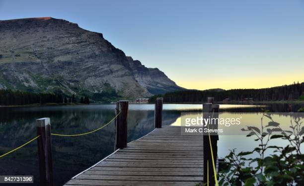 A Boat Dock with a View to the Many Glacier Hotel and Mount Henkel