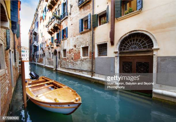 Boat Docked Along Canal in Venice, Italy