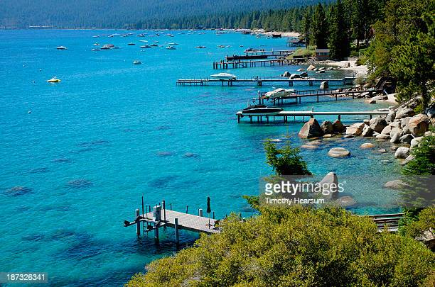 boat docks and moored boats in a cove - timothy hearsum stock photos and pictures
